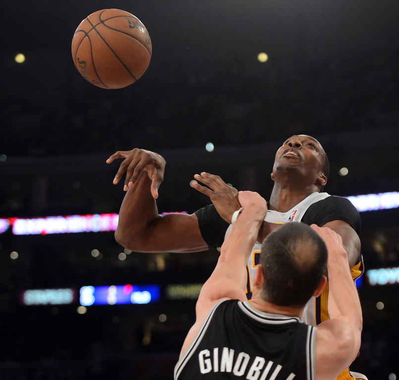 . The Lakers\'  Dwight Howard #12 is fouled by the Spurs\' Manu Ginobili #20 during game four of their NBA Western Conference playoffs at the Staples Center Saturday, April 28, 2013. The Spurs beat the Lakers 120-89. (Hans Gutknecht/Staff Photographer)