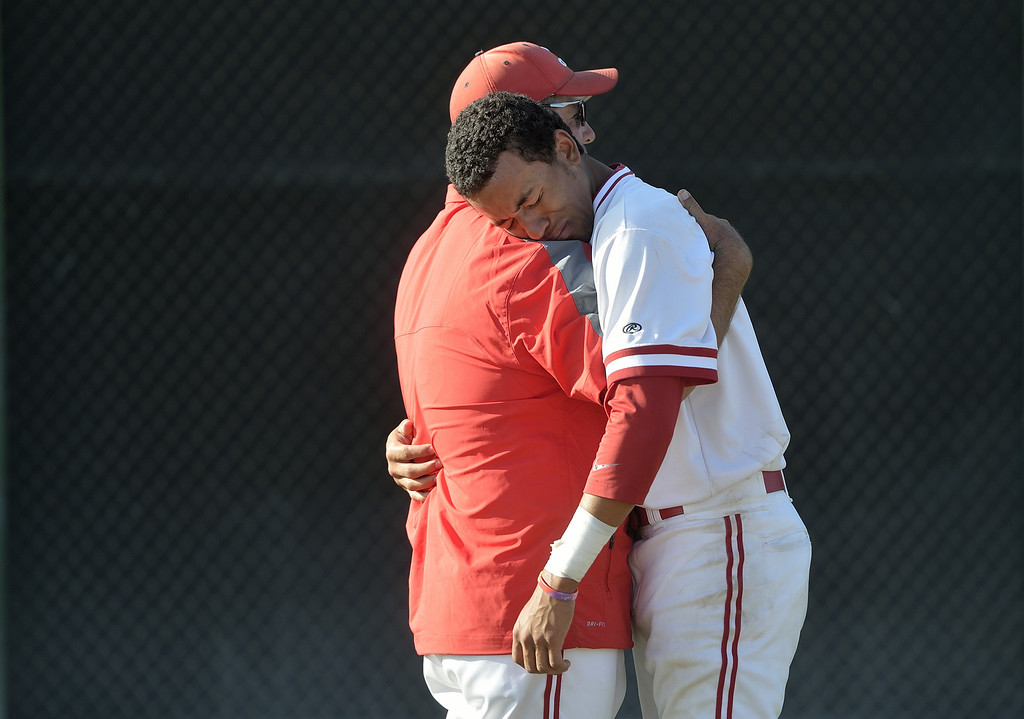 . LAKEWOOD, CALIF. USA -- Lakewood Assistant Coach Chris Vieira, left, consoles J.P. Crawford (2) after their CIF-SS Division I playoff loss to Loyola in Lakewood, Calif., on Tuesday, May 21, 2013. Loyola defeated Lakewood, 6 to 3. Photo by Jeff Gritchen / Los Angeles Newspaper Group
