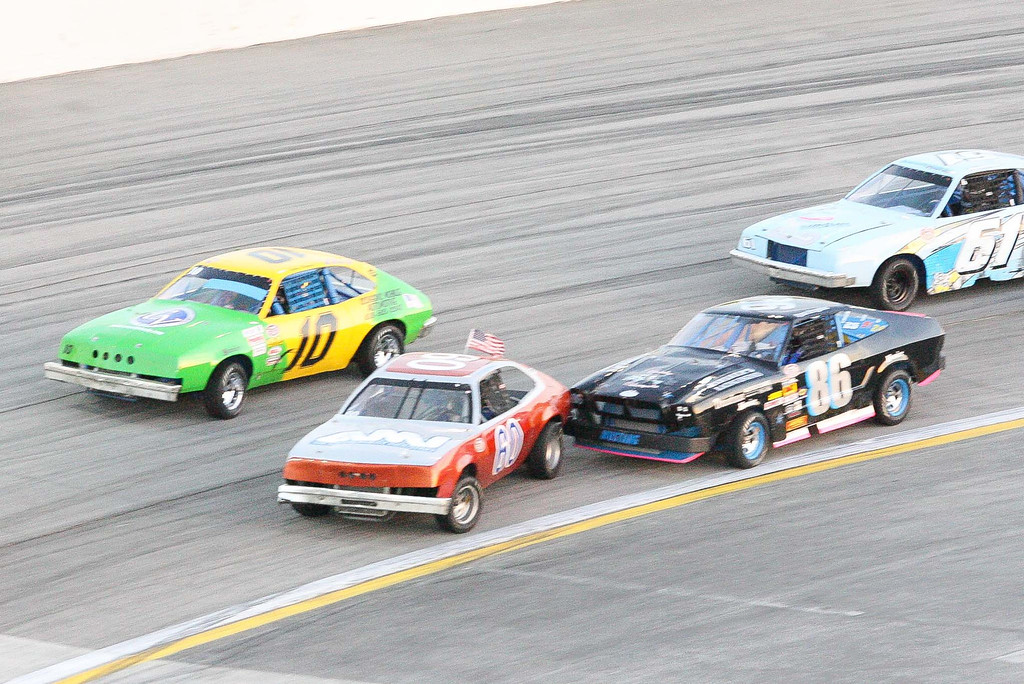 Description of . Ryan Bragdon (86) bumps Kevin Bernharc (60) in the mini stock race opening night of racing at Irwindale Speedway Saturday April 6, 2013. (Correspondent photo by Chris Burt)