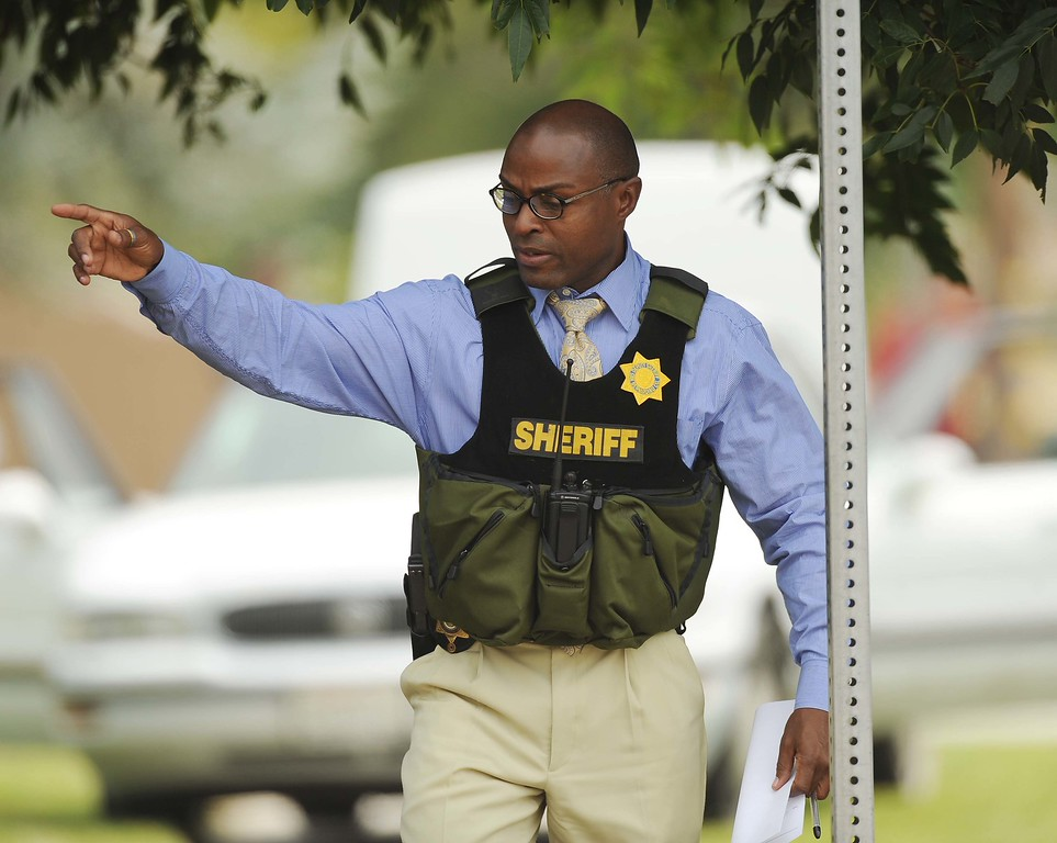 Description of . Deputies search for a man suspected of shooting another man in the 25400 block of West Pacific St. near Del Rosa Avenue on Thursday. (LaFonzo Carter/ Staff Photographer)