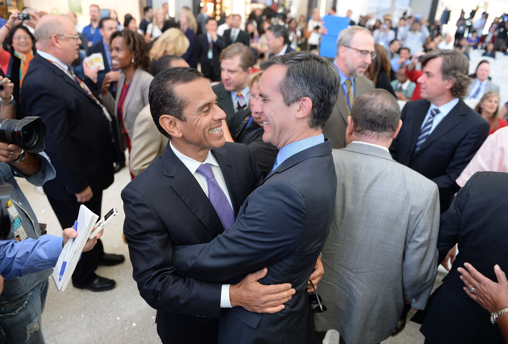 . Mayor Eric Garcetti, right, greets former Mayor Antonio Villaraigosa. At LAX, dignitaries gathered to open the new Tom Bradley International Terminal. (Wed. Sept 18, 2013 Photo by Brad Graverson/The Daily Breeze