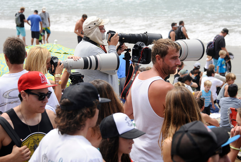 . Photographers started to loose their space from the huge crowds during the 2013 Vans US Open of Surfing Sunday at Huntington Beach CA. July 27,2013. Photo by Gene Blevins/LA DailyNews
