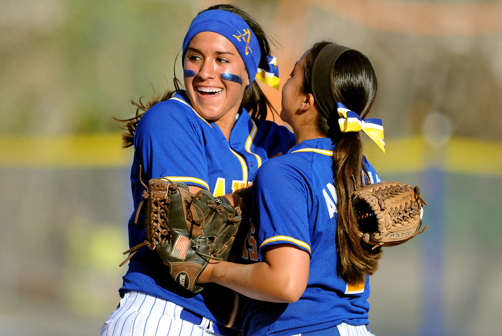 Description of . Bishop Amat's Brandy Galaviz ©, left, reacts with teammate Sabrina Anguiano after defeating Santiago 5-3 during a prep softball game at Bishop Amat High School on Wednesday, March 27, 2013 in La Puente, Calif.  (Keith Birmingham Pasadena Star-News)