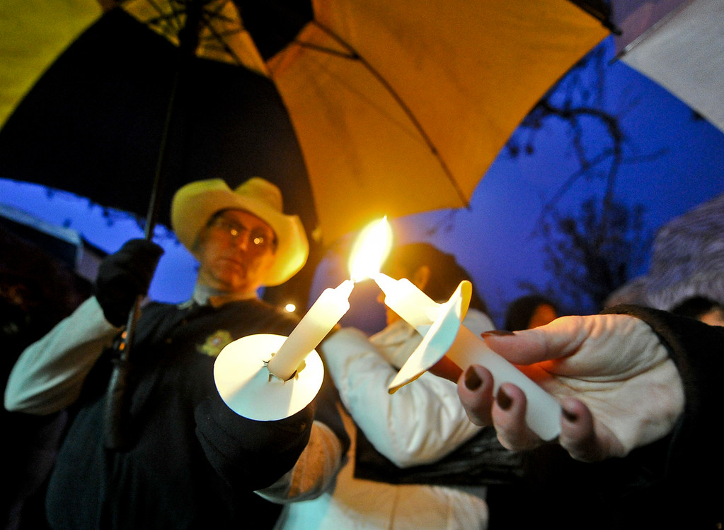 . Hundreds of people light candles in the rain during a candlelight vigil in honor of fallen San Bernardino County Sheriff\'s Detective Jeremiah MacKay at the Yucaipa Community Center in Yucaipa, Calif. on Tuesday, Feb. 19, 2013. MacKay was killed by fugitive ex-cop Christopher Dorner on Feb. 12 during a fiery shootout in which Dorner barricaded himself in a cabin near Big Bear. (Rachel Luna / Staff Photographer)
