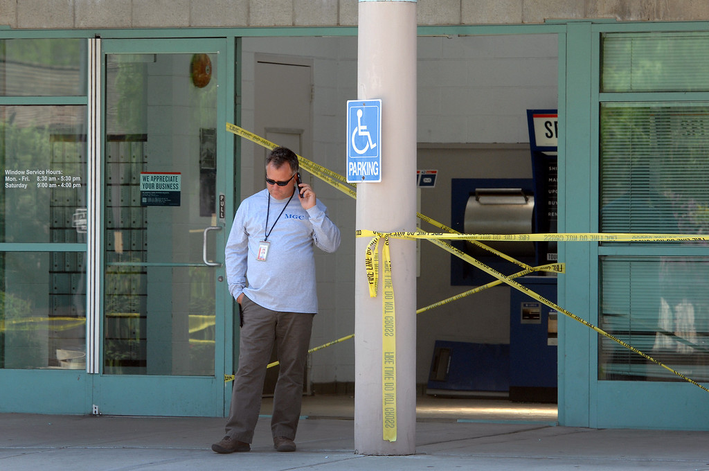. A man stands in front of the West Hills post office on Sherman Way after a car crashed into the lobby Thursday morning, August 22, 2013. One person inside the post office was hurt and the post office closed for the day. (Michael Owen Baker/L.A. Daily News)
