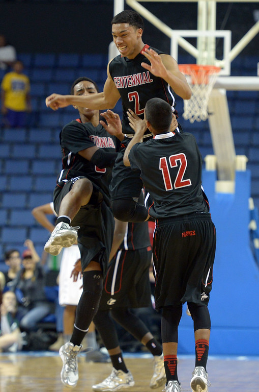 . Centennial players celebrate their win over Chino Hills at Citizens Business Bank Arena in Ontario, CA on Saturday, March 22, 2014. Chino Hills vs Centennial in the CIF boys Div 1 regional final. 2nd half. Centennial won 80-73 in overtime, Photo by Scott Varley, Daily Breeze)