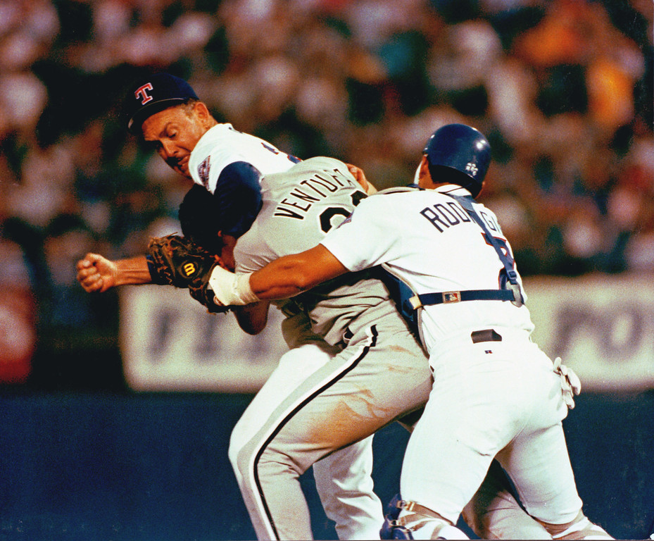 . Texas Ranger pitcher Nolan Ryan hits Robin Ventura of the Chicago White Sox after Ventura charged the mound in Arlington, Tex., on Aug. 4, 1993.  (AP Photo)