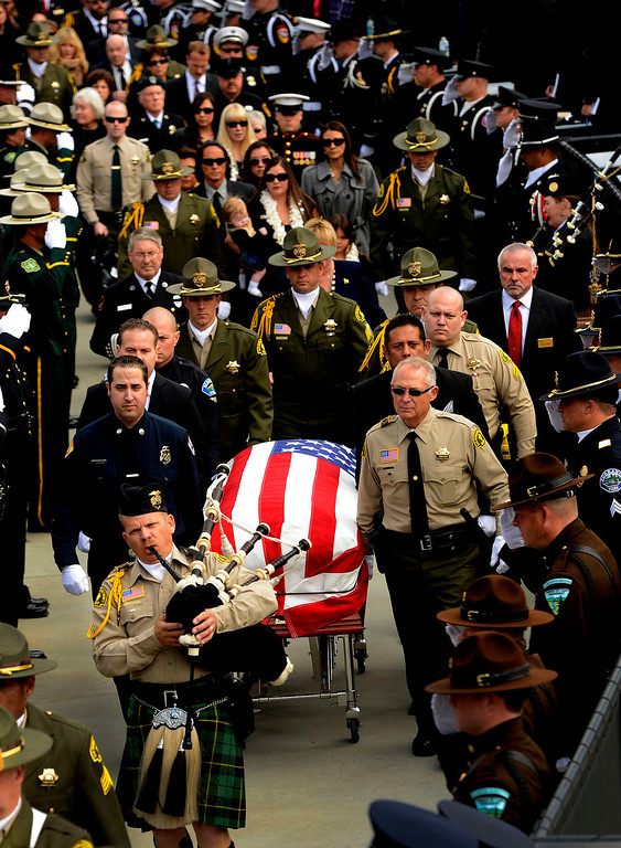 Description of . The procession for San Bernardino County Sheriff Deputy Jeremiah MacKay enters the San Manuel Amphitheater in Devore February 21, 2013.  GABRIEL LUIS ACOSTA/STAFF PHOTOGRAPHER.