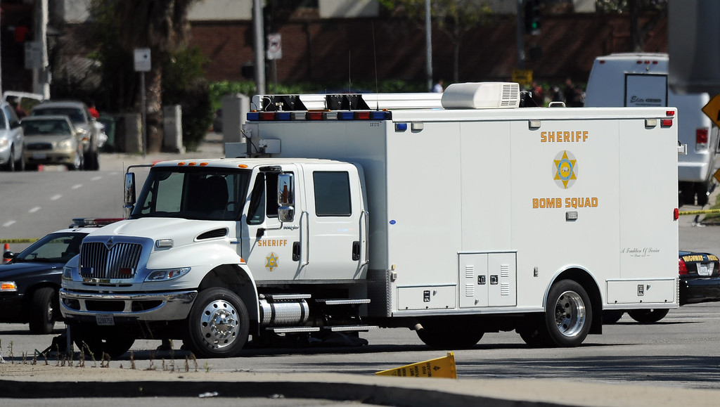 Description of . Los Angeles County Sheriff's bomb squad along with California Highway Patrol set-up in front of a McDoanlds where a suspicious backpack was being investigated as the campus of Cal State Los Angeles was closed earlier in the day to to a bomb threat on Thursday, April 18, 2012 in Los Angeles, Calif.    (Keith Birmingham/Pasadena Star-News)