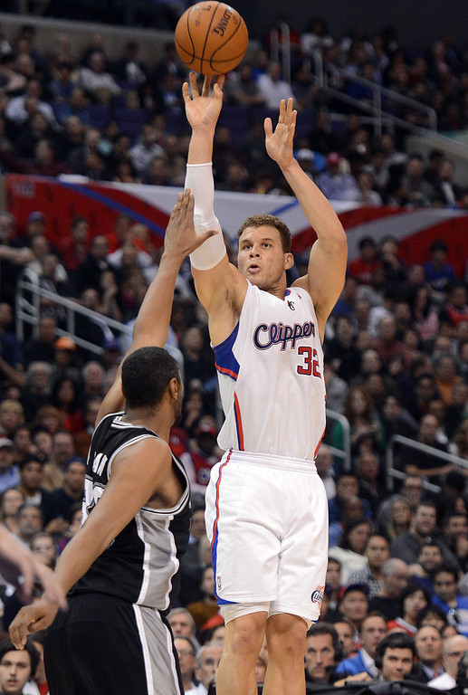 . The Clippers\' Blake Griffin #32 shoots as the Spurs\' Boris Diaw #33 defends during their game at the Staples Center in Los Angeles Friday, February  21, 2013. The Spurs beat the Clippers 116-90. (Hans Gutknecht/Staff Photographer)