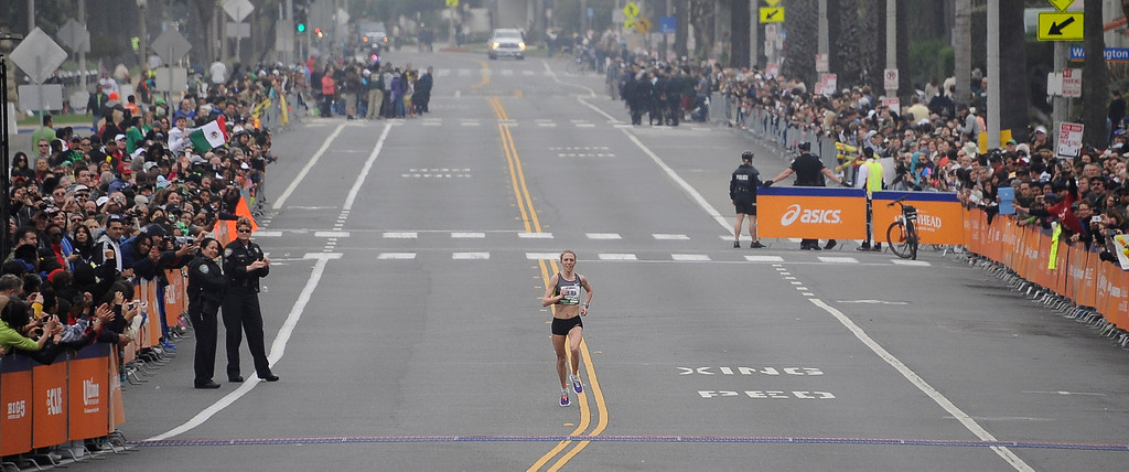 . Aleksandra Duliba out in front by her self as she was is the first woman to cross the finish line during the 2013 LA Marathon. Santa Monica March 17,2013. Los Angeles Photo by Gene Blevins/LA DailyNews