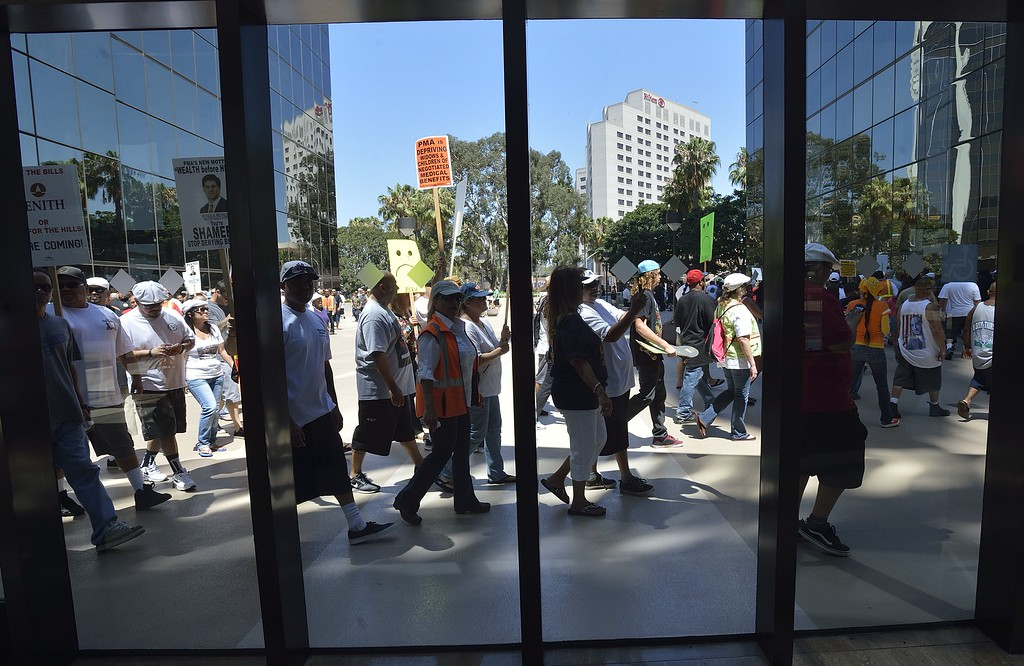. LONG BEACH, CALIF. USA -- Dock workers protest the Pacific Maritime Association (PMA) handling of their health care benefits on Monday, July 8, 2013, at the Molina Center in Downtown Long Beach, Calif.  Photo by Jeff Gritchen / Los Angeles Newspaper Group