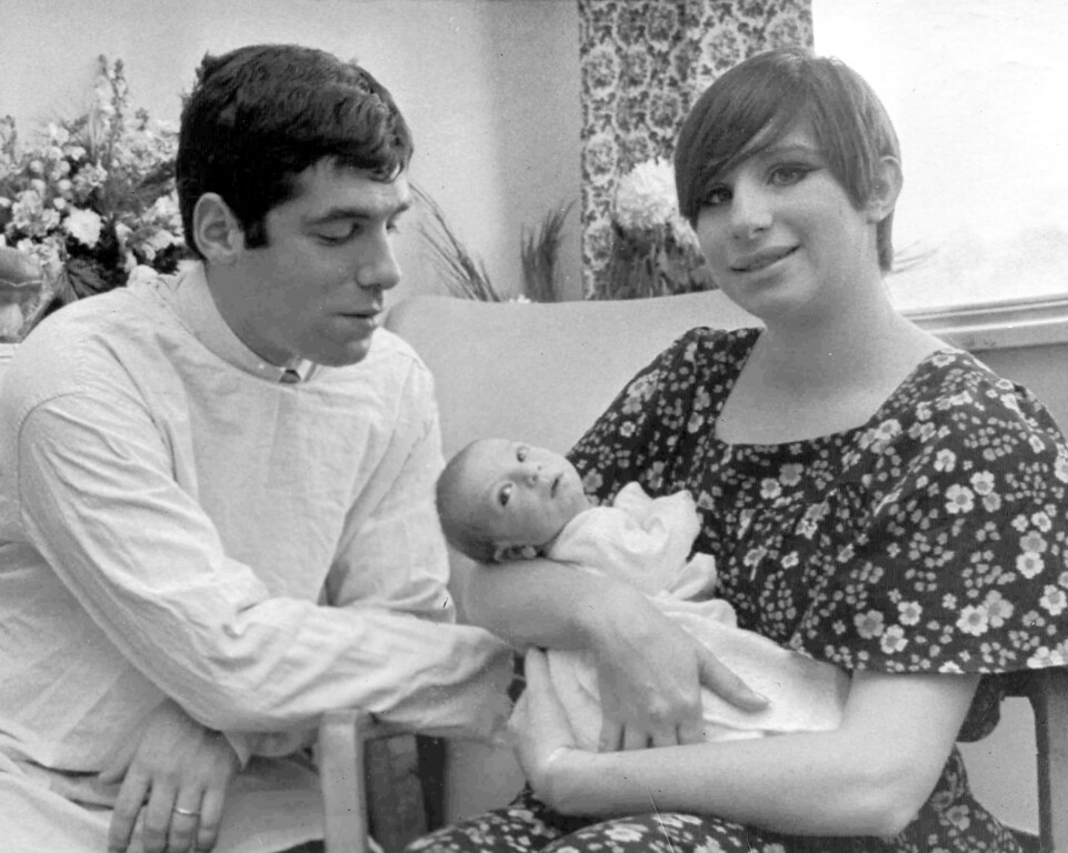 . Singer Barbra Streisand holds their son Jason Emanuel, as her husband Elliott Gould watches in New York\'s Mount Sinai Hospital, Jan. 9, 1967. The baby had been born Dec. 29. (AP Photo)