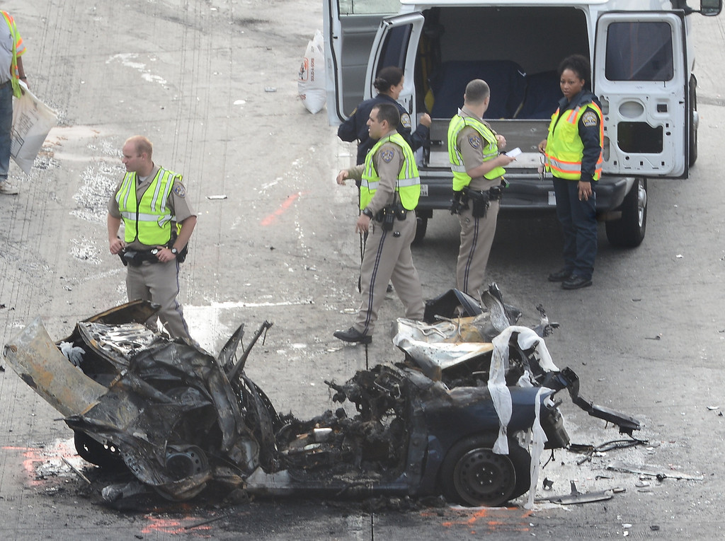 . CHP and LA coroner on the scene were 2 people were killed on the west 118 freeway at White Oak early Monday morning. The crash involved 2 cars and a semi truck with one car bursting into flames. All the lanes were shut down on the west bound side for 5hrs and the freeway open back up at 9am. Granada Hills CA. April 1,2013 PHOTO BY Gene Blevins/LA DailyNews