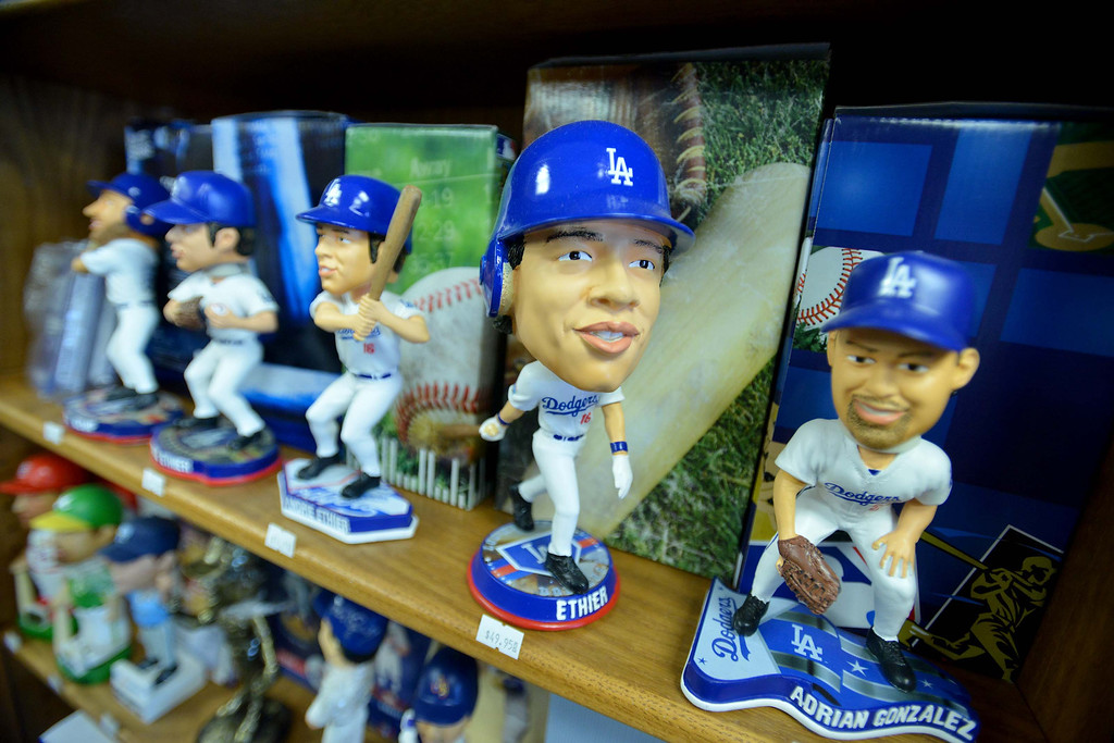 . 04-26-2013-(LANG Staff Photo by Sean Hiller)- David Perahia and Kevin Kong have the world\'s biggest bobblehead store in Lomita called Baseball Cards and Bobbleheads Inc.