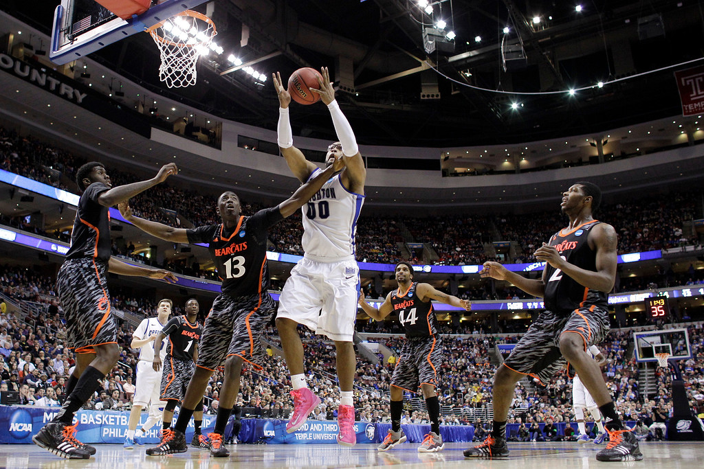 . Creighton\'s Gregory Echenique pulls in a rebound against Cincinnati\'s Cheikh Mbodj (13) during the second half of a second-round game of the NCAA men\'s college basketball tournament, Friday, March 22, 2013, in Philadelphia. Creighton won 67-63. (AP Photo/Matt Slocum)