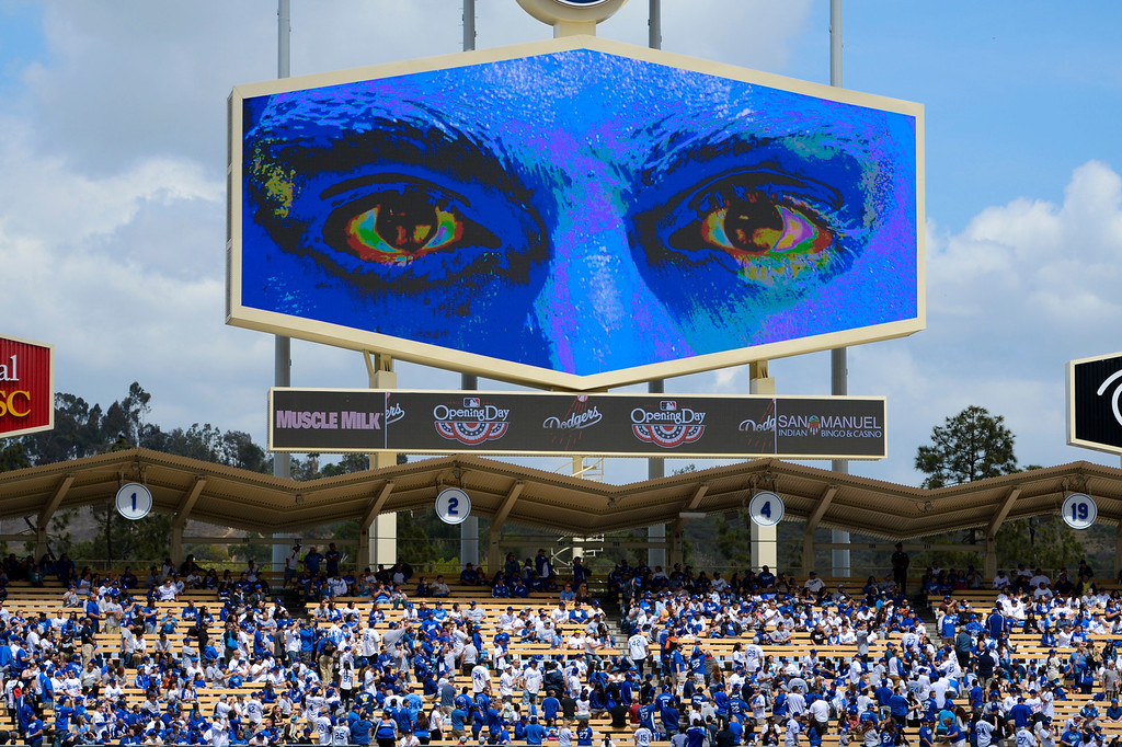 . The Blue Man Group is displayed on the new Dodger screen as they perform at opening day at Dodger Stadium Monday.  Photo by David Crane/Los Angeles Daily News.
