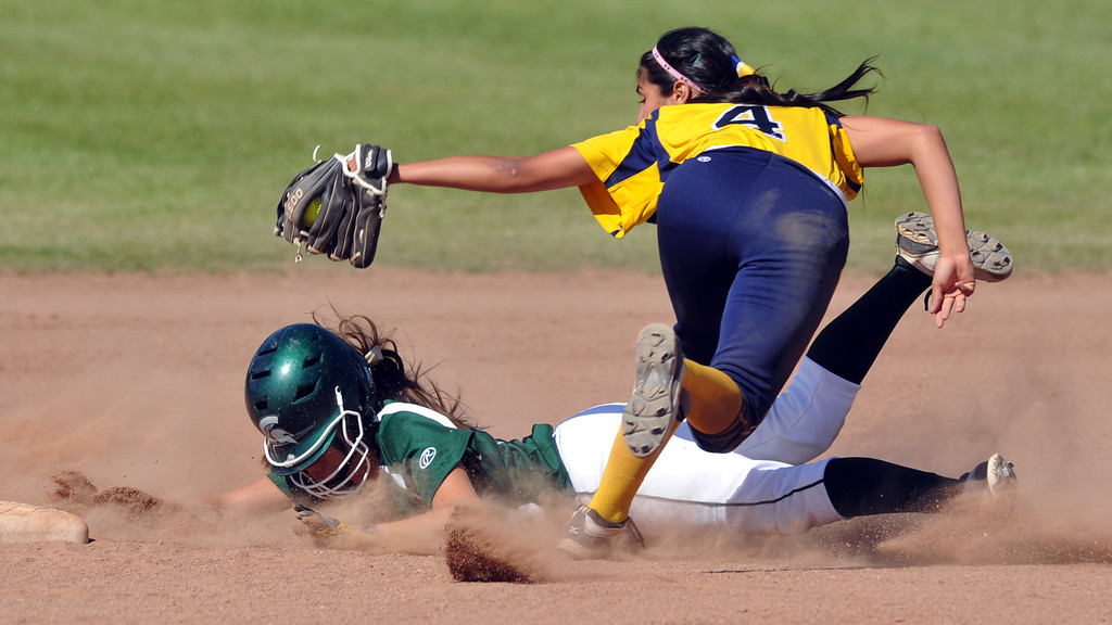 . Montebello shortstop Brianna Alvarez (#4) tags out  Schurr\'s Stephanie Guido (#23) in their Almont League girls softball game at Montebello High School on Thursday April 18, 2013. Montebello beat Schurr 10-8. (SGVN/Staff Photo by Keith Durflinger)