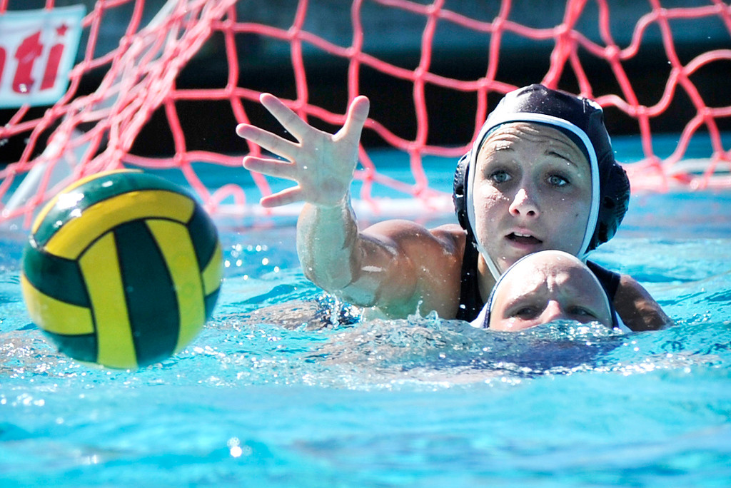 . MANHATTAN BEACH - 2/16/2013 - (Mark Savage) GIRLS WATER POLO: Arroyo Grande at Mira Costa. CIF Southern Section Division III quarterfinal. Mira Costa player #11 Sarah Crist reaches for the ball over Arroyo Grande player #5 Brooklyn VanderVeen during the first half of the game.
