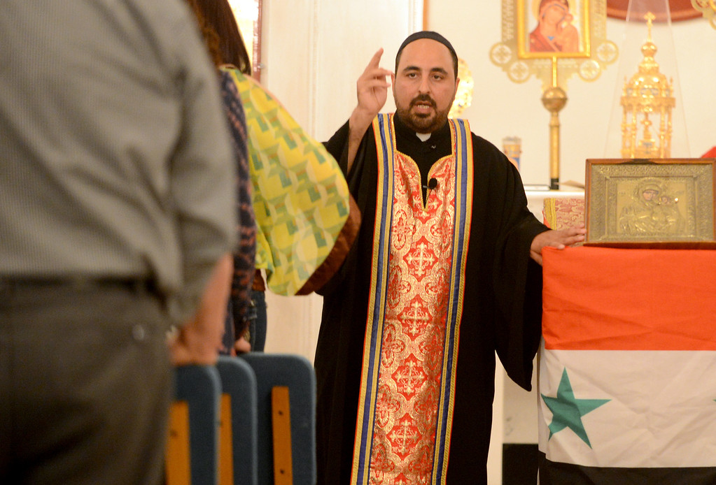 Description of . Rev. Father John Saif leads prayer at St. Elias Syriac Orthodox Church in Upland for the two prominent Syrian bishops who have been kidnapped on Monday by armed rebels. A Syriac member of the opposition Syrian National Coalition, Abdulahad Steifo, said the men had been kidnapped on the road to Aleppo from the rebel-held Bab al Hawa crossing with Turkey. (Thomas R. Cordova/Staff Photographer)