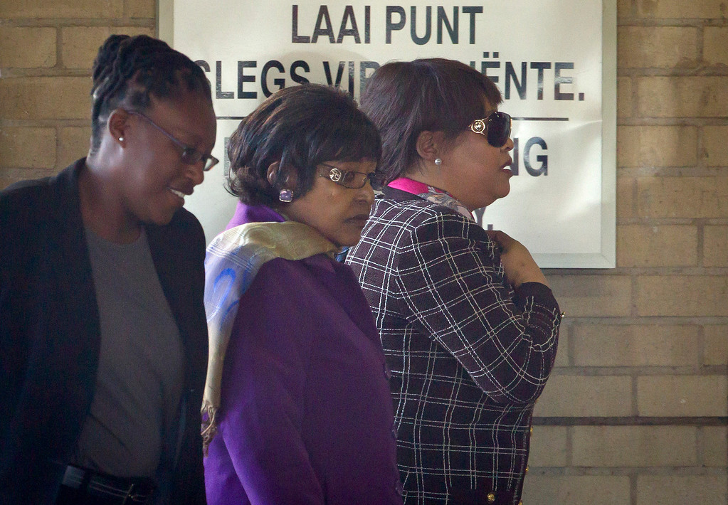 . Former wife Winnie Madikizela-Mandela, center, and daughter Zindzi Mandela, right, along with an unidentified woman who is not a relative, left, arrive at the Mediclinic Heart Hospital where former South African President Nelson Mandela is being treated in Pretoria, South Africa Wednesday, June 26, 2013. There was no word early Wednesday on 94-year-old Mandela\'s condition, which was critical a day earlier, according to the government. (AP Photo/Ben Curtis)