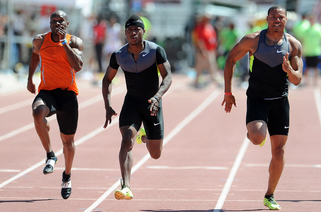 Description of . Mike Rodgers, center, of Nike wins the 100 meter dash invitational elite during the Mt. SAC Relays in Hilmer Lodge Stadium on the campus of Mt. San Antonio College on Saturday, April 20, 2012 in Walnut, Calif.    (Keith Birmingham/Pasadena Star-News)