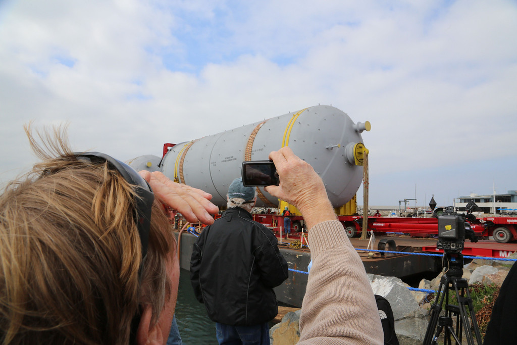 . The first two of six massive coke drums bound for El Segundo\'s Chevron oil refinery reached Redondo Beach on Monday, causing a flurry of activity at the waterfront. The behemoth 500,000-pound drums that will replace 1960s-era models in the refinery\'s coker unit and reached King Harbor about 7 a.m. after a trip by barge from the Port of Los Angeles. They were then loaded onto a transporter and off loaded from the barge. Chuck Bennett/Staff Photographer