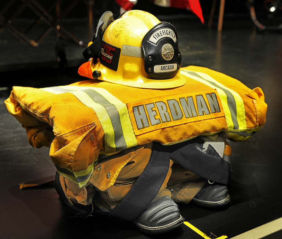 . Michael Herdman Arcadia Fire Department uniform at memorial service on Wednesday, July 9, 2014, for the Arcadia firefighter-paramedic found dead in the Los Padres National Forest last Friday. Herdman, an avid adventurer, died after becoming separated from his camping partner. He fell from a cliff and was killed by his injuries. Searchers canvassed the forest for 11 days before finding his body.(Photo by Walt Mancini/Pasadena Star-News)