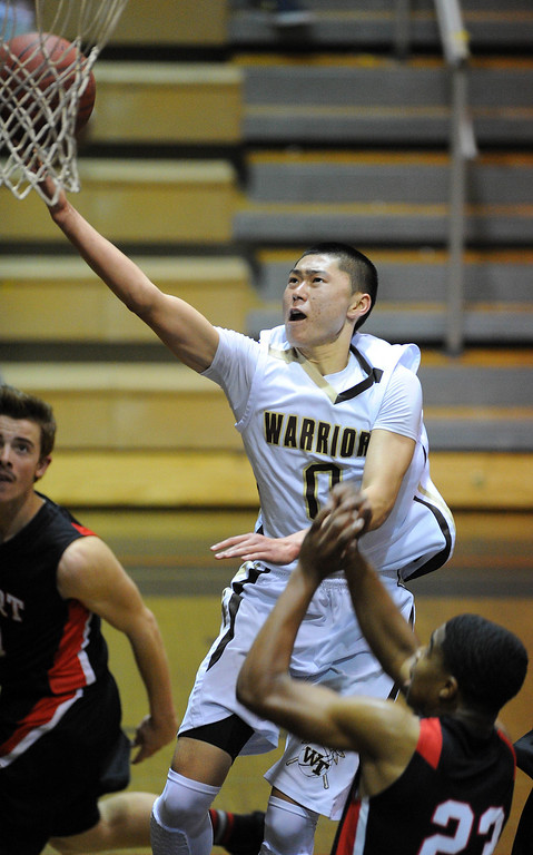 . TORRANCE - 02/15/2013 - (Staff Photo: Scott Varley/LANG) In a CIF Southern Section Division III-AAA second-round boys basketball matchup, West beat Hart 64-55. West\'s Ethan Kishimoto lays up a basket.