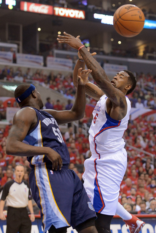 . Clippers center DeAndre Jordan battles for a rebound with Zach Randolph of the Memphis Grizzlies during game 2 of the 2013 NBA Western Conference Playoffs April 22, 2013 in Los Angeles, CA.(Andy Holzman/Staff Photographer)