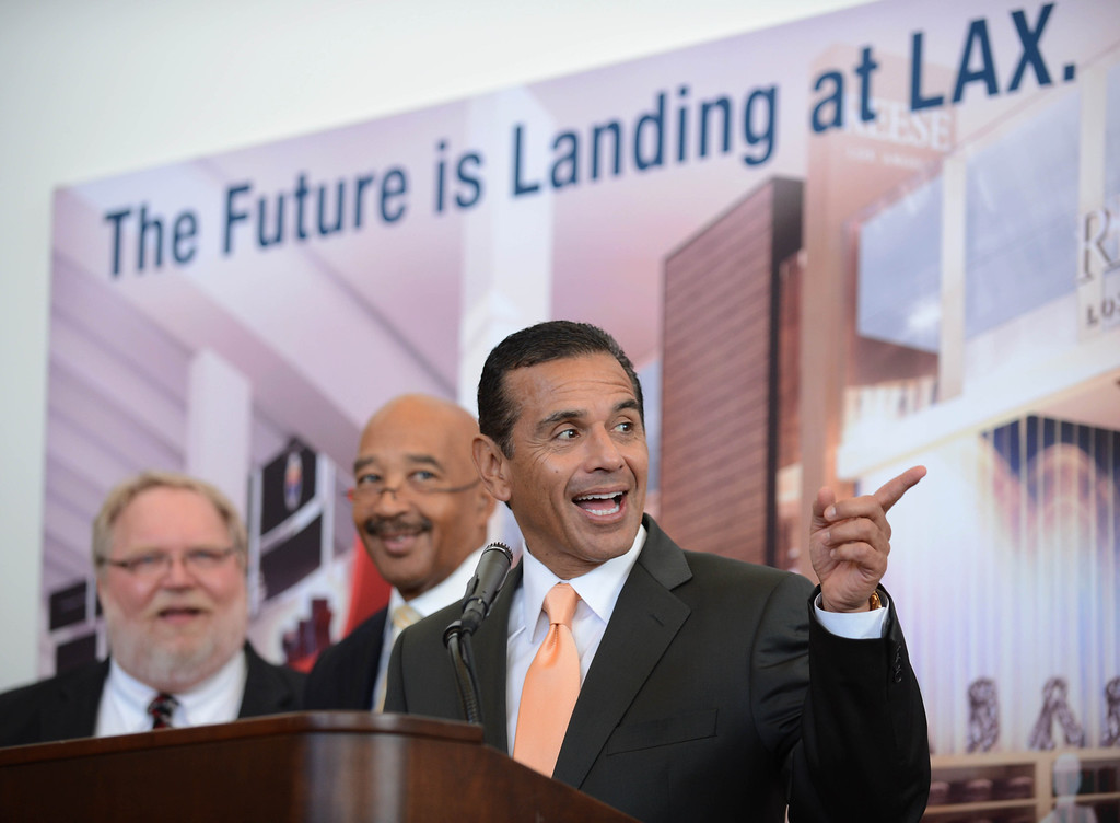. At LAX Wednesday, Mayor Villaraigosa and LAX officials unveiled new aircraft gates in the Tom Bradley International Terminal (TBIT). The gates feature laser-based docking technology and computerized boarding bridges to accomodate larger aircraft like the Boeing 747-8 and Airbus 380.   Photo by Brad Graverson 3-6-13