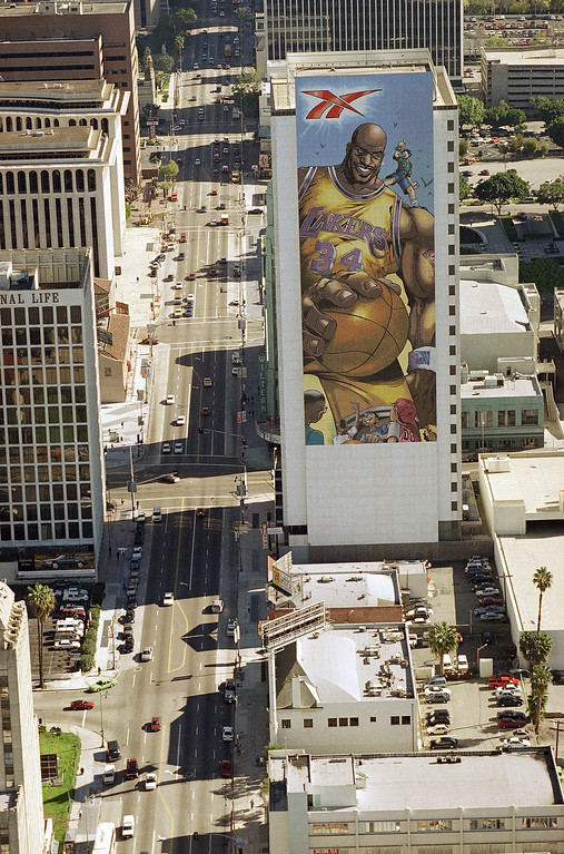 . This is an aerial view of a building in downtown Los Angeles showing a mural of Los Angeles Lakers center Shaquille O?Neal, seen on Thursday, Jan. 16, 1996. (AP Photo/Kevork Djansezian)