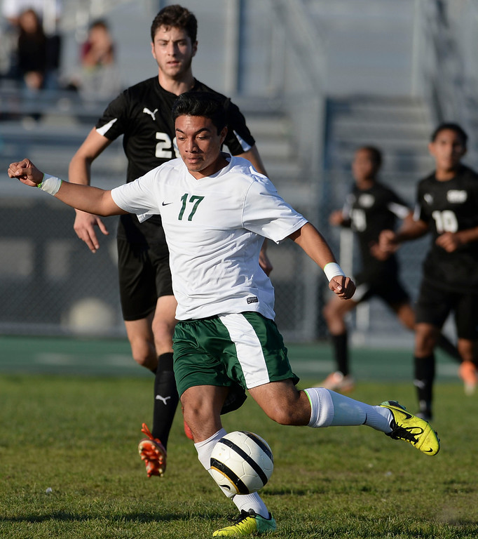 . Narbonne\'s Marco Cortez (17) moves the ball up field on San Pedro in a Marine League boys soccer game Wednesday, February 12, 2014, Harbor City, CA.  Narbonne won 2-0 and seals the league title. Photo by Steve McCrank/Daily Breeze