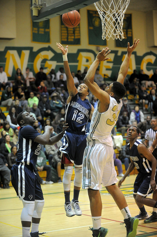 . 02-19-2012--(LANG Staff Photo by Sean Hiller)-Poly defeated Mayfair 73-28 in the second round of the Division I-AA boys basketball playoffs Tuesday night. Mayfair\'s Jarrod Sheffield sails for two points fourth quarter.