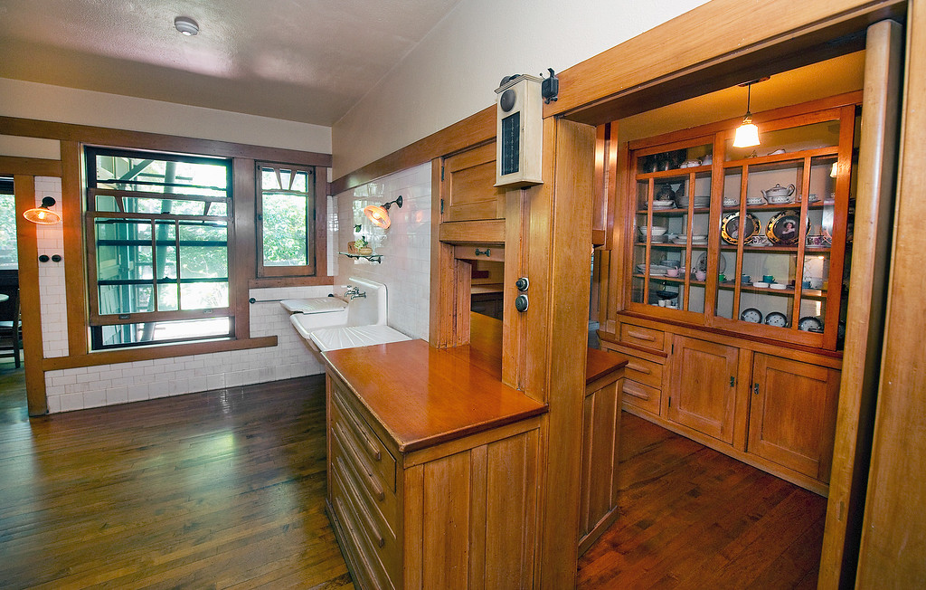 "Description of . Kitchen and butler's pantry area with a food-pass through from the kitchen to the pantry area and the food was then served in the dining room at the Gamble House Tuesday, July 16, 2013. Fans of the BBC's ""Upstairs/Downstairs"" and ""Downton Abbey"" can get a rare, behind-the-scenes look at the real deal when the Gamble House, located at  4 Westmoreland Place in Pasadena. The Gamble House opens up its servants quarters for three weeks only, beginning Aug. 1. The tour is based on new findings about the Gamble family and its servants. Part of the first floor will be closed on the tour due to renovations.(SGVN/Photo by Walt Mancini)"