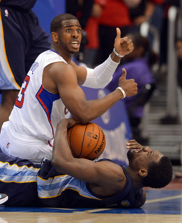 . Clippers guard Chris Paul looks for a jump ball call after scrambling for a loose ball with Tony Alllen of the Memphis Grizzlies during game 2 of the 2013 NBA Western Conference Playoffs April 22, 2013 in Los Angeles, CA.(Andy Holzman/Staff Photographer)