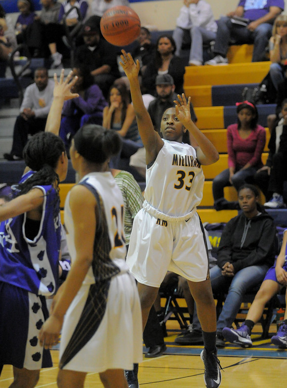 . 02-16-2012--(LANG Staff Photo by Sean Hiller)- Millikan vs. Rancho Cucamonga in Saturday night\'s  first-round CIF girls basketball game at Millikan High School in Long Beach. Mia Belvin gets the basket for Millikan.