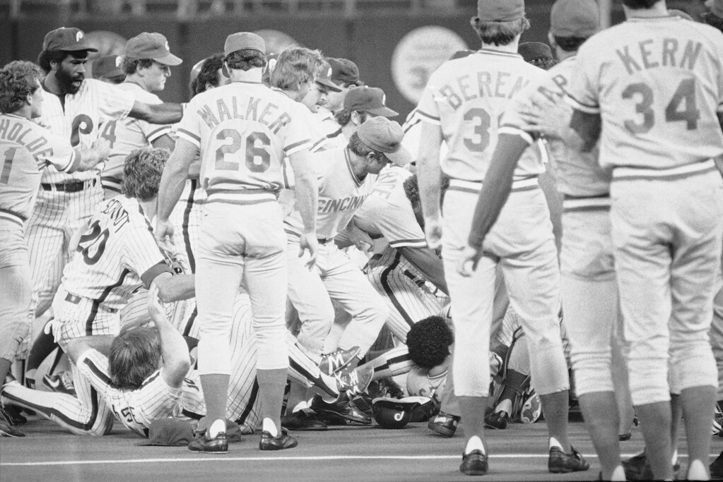 . Both benches from the Phillies and the Reds emptied onto the field after Reds pitcher Mario Soto was hit by a pitch from Phillies Ron Reed in the 7th inning of play, Monday, June 1, 1982, Philadelphia, Pa. Soto went after Reed and a brawl between the two teams. Three players were thrown out of the game, Phillies Ron Reed, and Reds Mario Sots, Dave Concepcion. Reds players Duane Walker (26), Paul Householder, left, Jim Kern (34) and Bruce Berenyi, third from right, appear in the foreground. The rest of the players are unidentified. (AP Photo/Steven Falk)