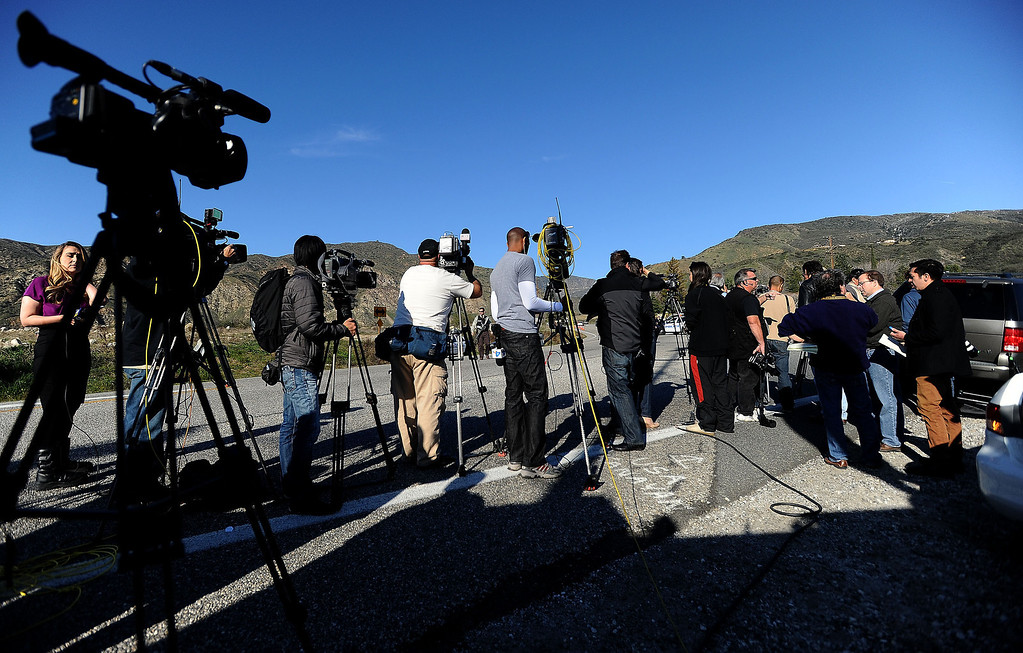 . Media reports from a blockade at Highway 38 and Bryant Street near the Mill Street Ranger Station west of Yucaipa February 12, 2013.  Authorities believe that they exchanged gunfire with fugitive Christopher Dorner in the Angeles Oaks area of the San Bernardino National Forest.  Fish and Game officers spotted a man fitting the description of Dorner driving a white pick-up, and two San Bernardino County Sheriff Deputies exchanged gunfire with him.  Authorities believe Dorner is holed up in a cabin on Glass Road and Highway 38.  GABRIEL