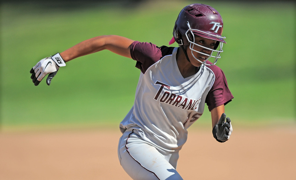 . TORRANCE - 04/03/2013  (Photo: Scott Varley, Los Angeles Newspaper Group)  South vs Torrance softball in a Pioneer League matchup. Torrance\'s Christina Washington sprints home to score on a ball hit by Mo Ramirez.
