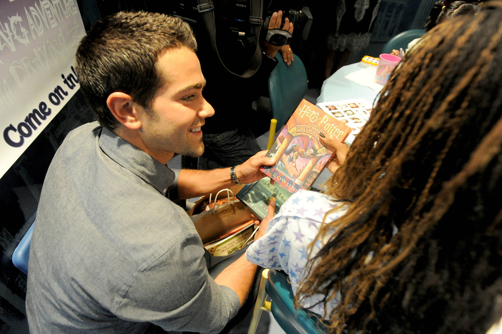 ". 04-18-2013-(LANG Staff Photo by Sean Hiller)-Toyota Grand Prix Celebrities visited Miller�s Children�s Hospital to visit the children they are raising money for through ""Racing for Kids.\"" Celebrity driver Jesse Metcalfe visits with patient Precious Welch at Thursday\'s event."