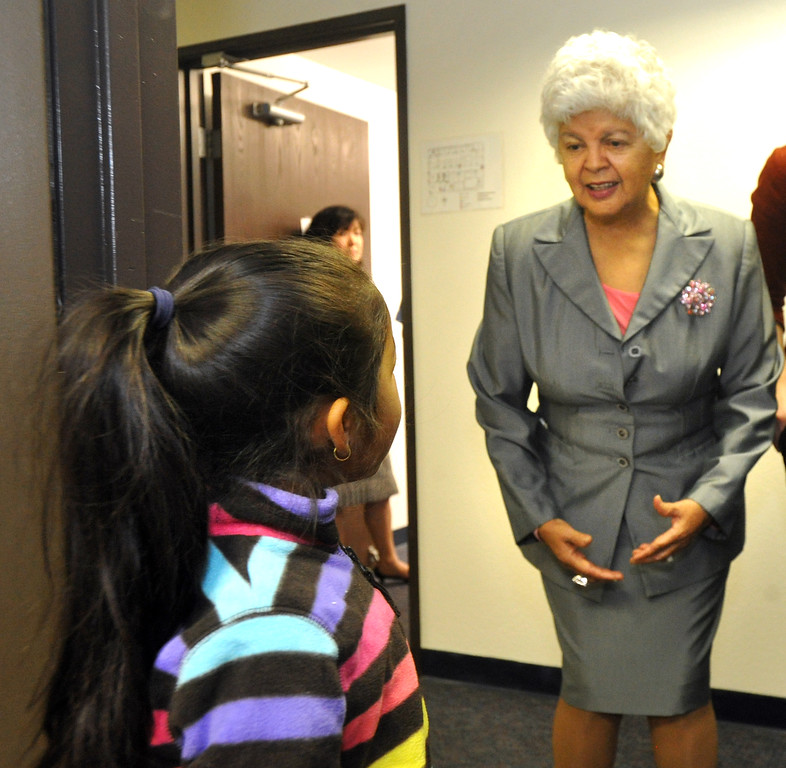 Description of . Yvonne Solorio, 6, talks with Congresswoman Grace Napolitano at Foothill Family Service's new El Monte South Family Center on Tuesday April 2, 2013. The family center provides mental health and social services for children and families in the greater El Monte area, including Early Head Start and school-based mental health services at local schools. (SGVN/Staff Photo by Keith Durflinger)