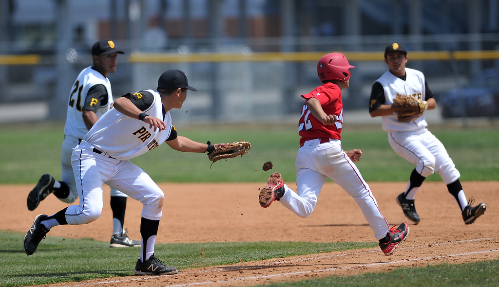 . 4/6/13 - San Pedro High School makes a play for an out on first during a non-league game against Arleta High School on Saturday morning at Harbor City College. Photo by Brittany Murray / Staff Photographer