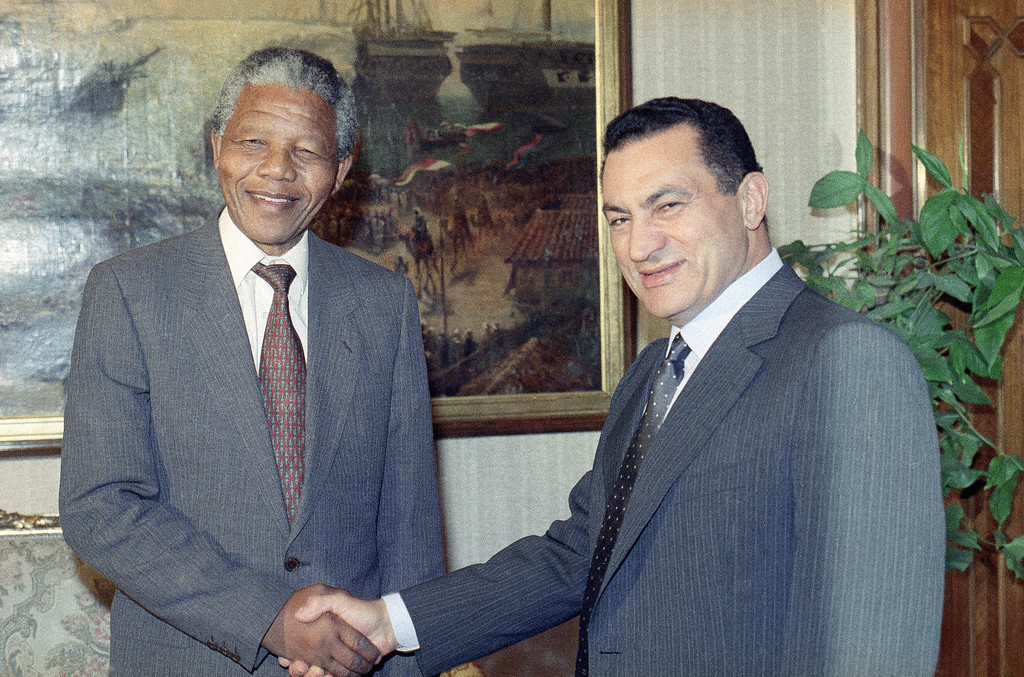. President Hosni Mubarak shakes hands with South African anti-apartheid leader Nelson Mandela who began a two-day state visit to Egypt in Cairo on May 19, 1990. (AP Photo/Axel Schulz-Eppers)