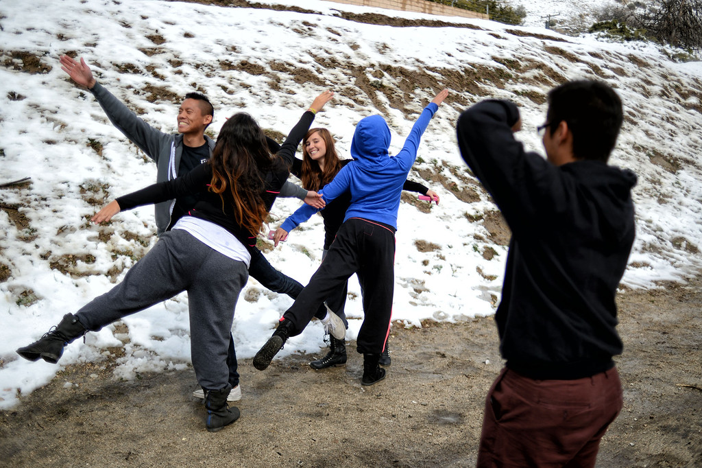 . Margarito Rivera takes a photo of  Joseph Gabritintina, Estephanie Vitela, Lynsey Mikels, and Brianne Risa. The friends stopped in Gorman to have some fun in the snow while on their way to San Jose. (Hans Gutknecht/Staff Photographer)