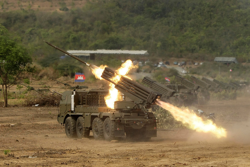 Description of . Cambodian army multiple rocket launchers are test fired at Phnom Sruoch complex of Cambodian army base, in Kampong Speu province, some 65 kilometers (40 miles) southwest of Phnom Penh, Cambodia, Tuesday, April 2, 2013. About 107 rounds of Russian-made BM-21 rockets were fired, according to the army. (AP photo/Heng Sinith)