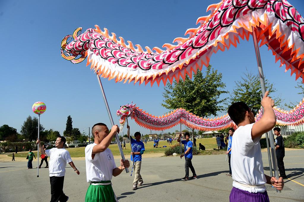 Description of . Matt Lau, of the San Gabiel Valley Chinese Cultural Association, teaches the dragon dance during the 4th Annual San Gabriel Youth Summit at Columbia School in El Monte Saturday, March 23, 2013. (SGVN/Staff Photo by Sarah Reingewirtz)
