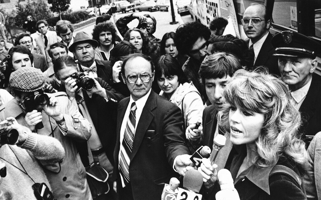 . Actress Jane Fonda speaks to the press on the steps of Buffalo City Hall on Thursday, Oct. 4, 1979 in Buffalo. as husband, Tom Hayden, looks on. The actress spoke on the dangers of chemical contamination before departing for the Love Canal chemical dumpsite in nearby Niagara Falls, New York. (AP Photo)