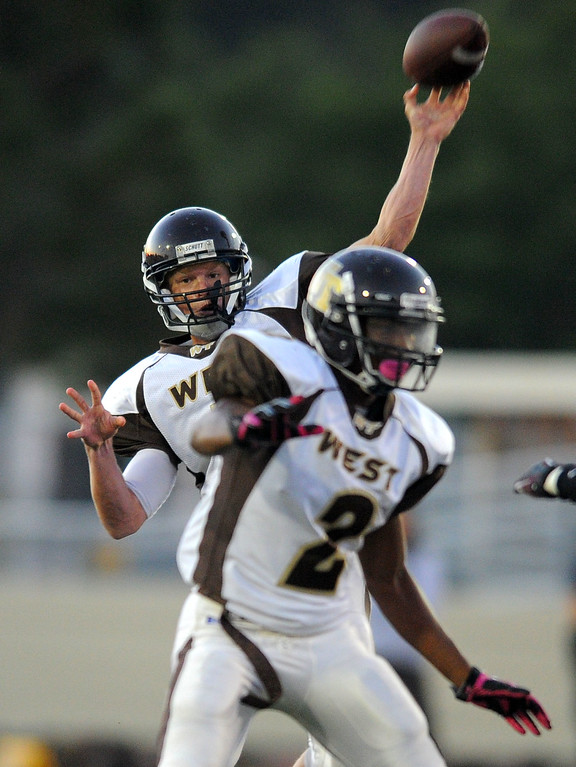 . West High takes on Torrance in a non league football game at Zamperini Stadium in Torrance, CA on Thursday, September 12, 2013. West QB Zach Heeger lets loose on a pass. (Photo by Scott Varley, Daily Breeze)