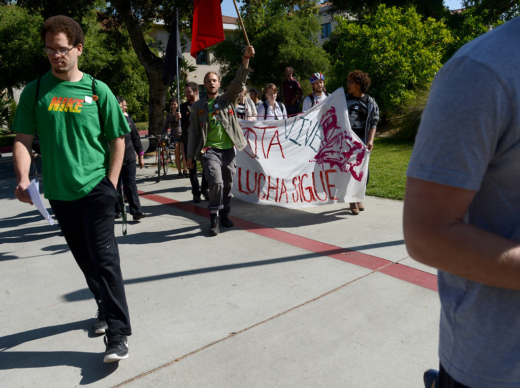 Description of . Pomona College dining hall workers and students hold a rally to announce a plan to file for a union election Wednesday, April 3, 2013, at Pomona College in Claremont. Jennifer Cappuccio Maher/Staff Photographer